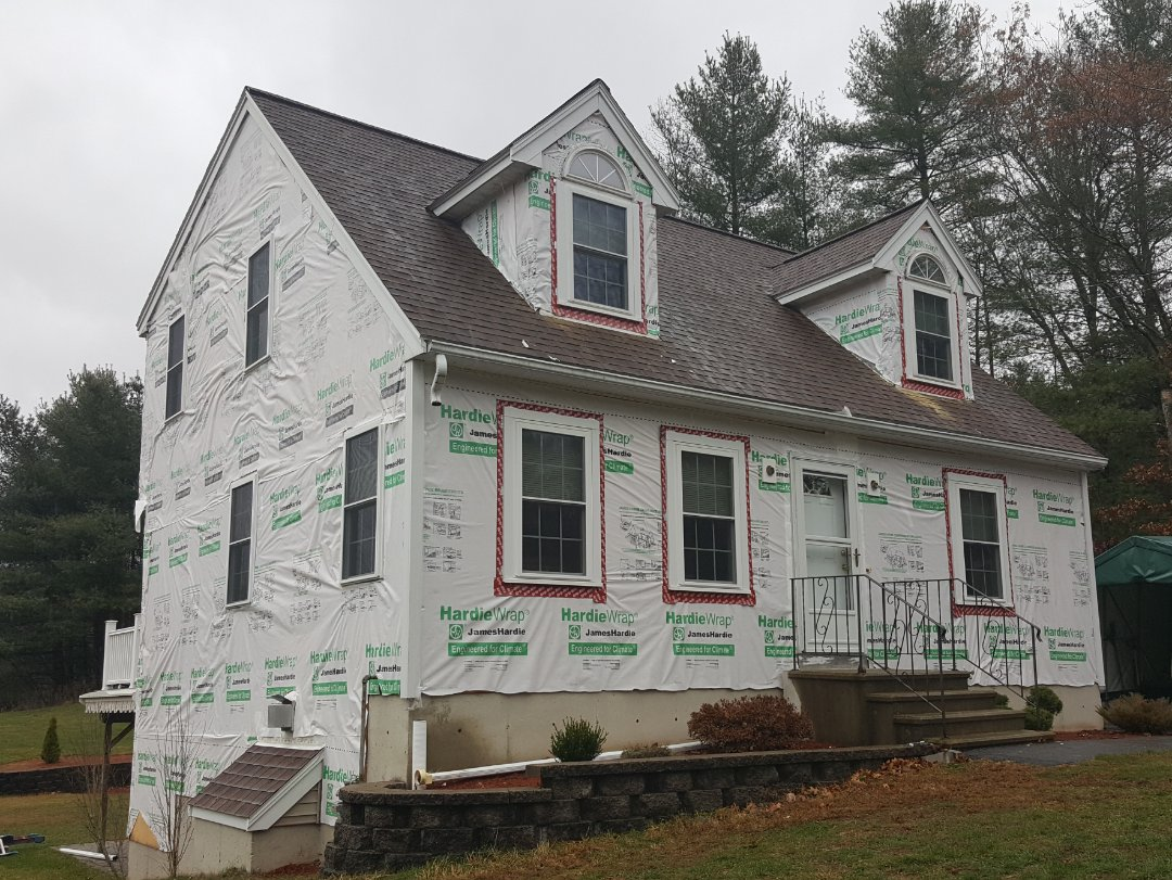 Tyngsborough, MA - Rain interrupted our siding project in this home in Tyngsboro.  We are in the process of installing #JamesHardie #FiberCement #Clapboard #Siding.  Home is already wrapped in #Hardiewrap.   #SolidStateConstructionMA  #MyHardieHome