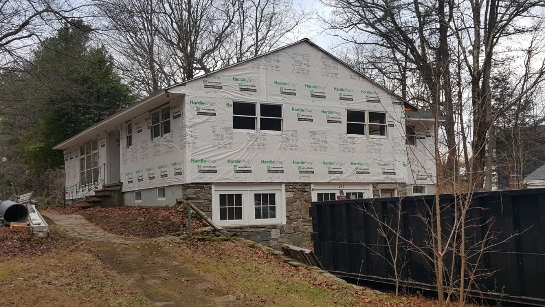 Groton, MA - We started working in this home in Groton, MA this morning.  All done in removing the old siding and now it's wrapped with #Hardie #HomeWrap.  It's all ready for the installation of  #JamesHardie #FiberCement #Clapboard #Siding.  #SolidStateConstructionMA  #MyHardieHome