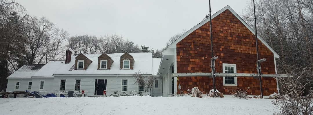 Franklin, MA - Dashing thru the snow as I check the progress of our crew in this home in Franklin, MA. We had just finished installing #JamesHardie #FiberCement #Clapboard #Siding.  They also installed #Wood #Cedar #Siding on the garage.    #SolidStateConstructionMA  #MyHardieHome