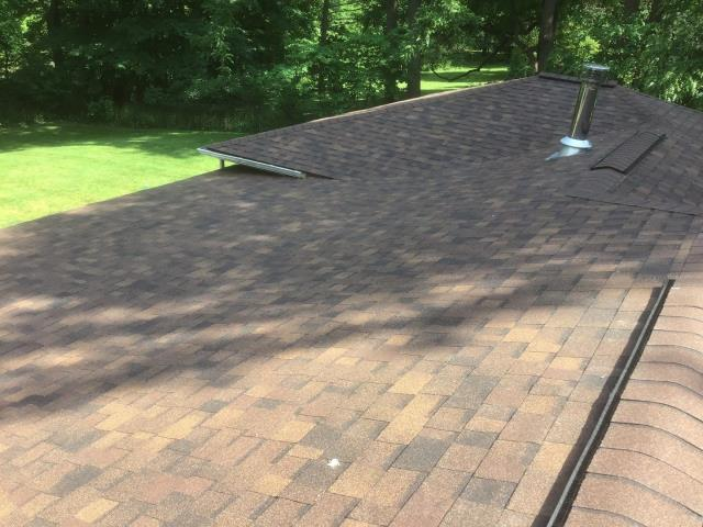 Plymouth, MI - The sun is shining and that means roofs are being replaced!