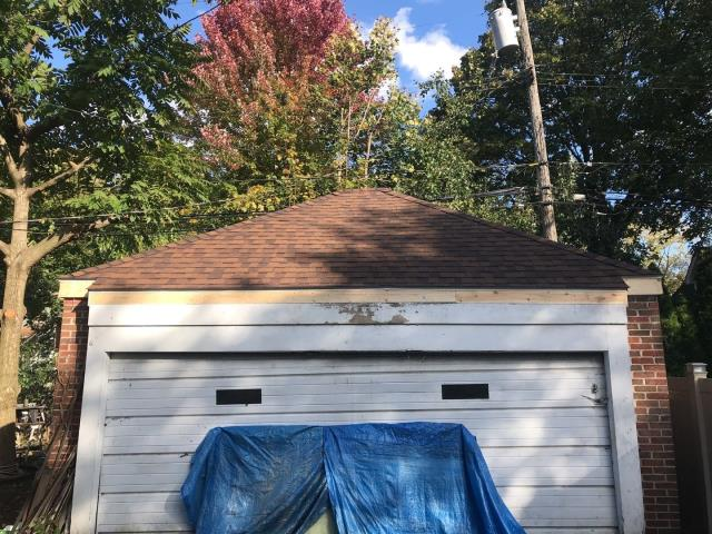 Plymouth, MI - A gnarly before and after on this garage roof we replaced. We are so glad to provide a new roof to make sure their things are protected.