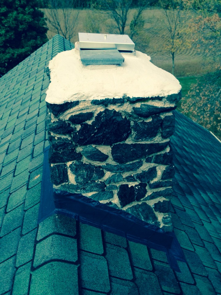 Hudson, WI - Applying flash seal, crown coat, and chimney saver. Installed top mounted damper