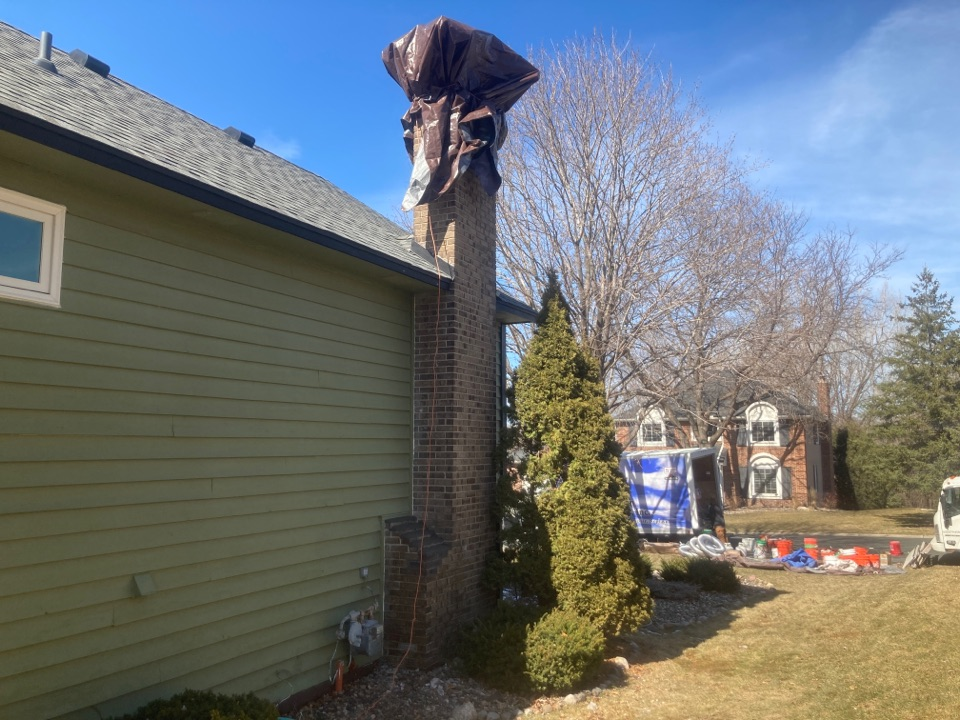 Eden Prairie, MN - 5 new courses of brick and a new crown- repaired shoulders
