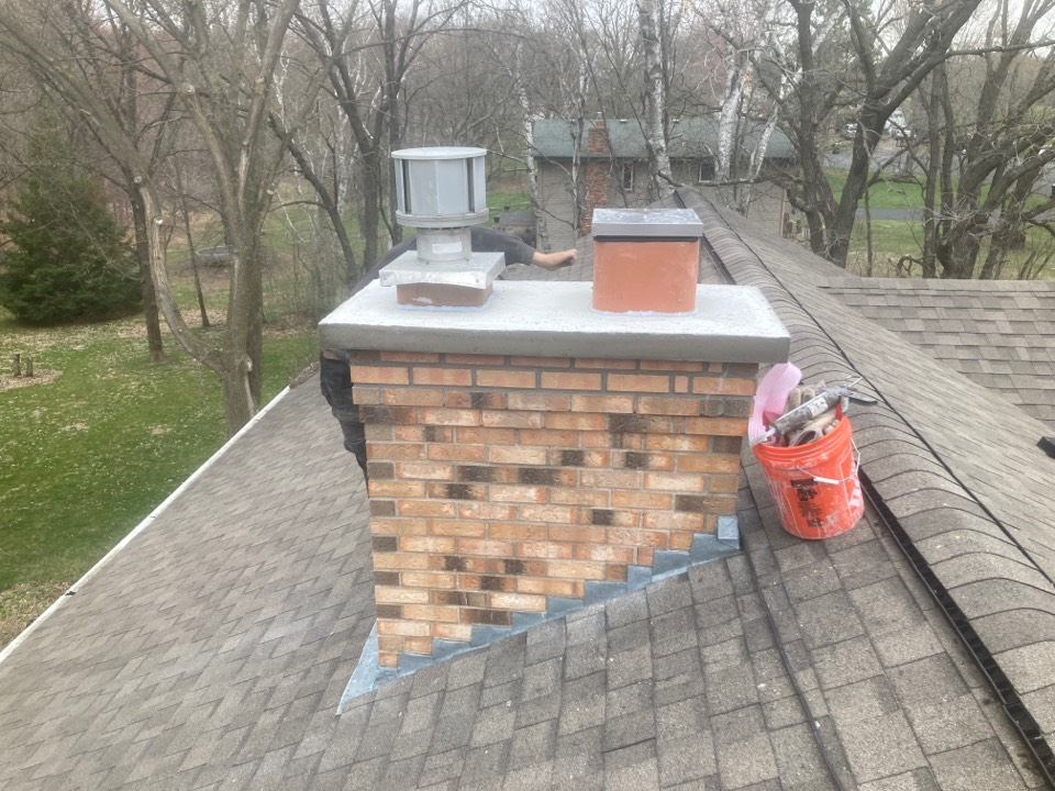 "East Bethel, MN - New crown- 2 courses of brick- new 10"" lining system and top mounted damper"