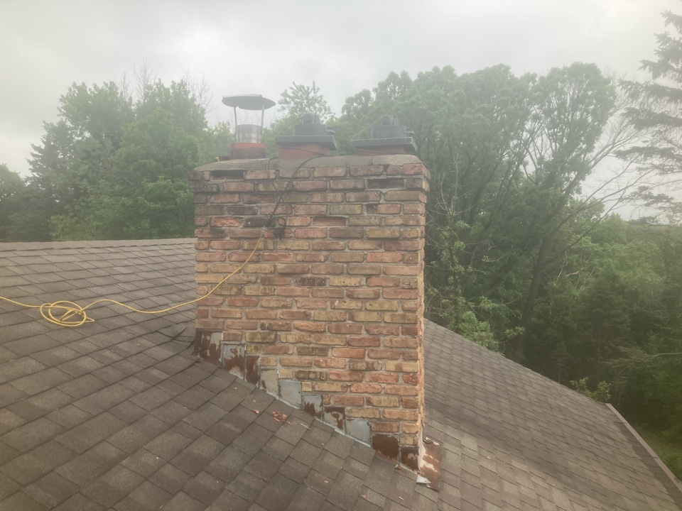 Mendota Heights, MN - Double chimney cleaning and smartscan flue liner inspection - booked for a roofline rebuild