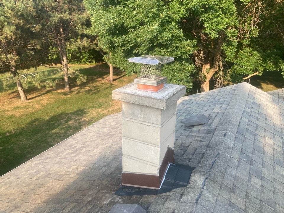"Bethel, MN - Roofline rebuild and 6"" liner install - final sealant"
