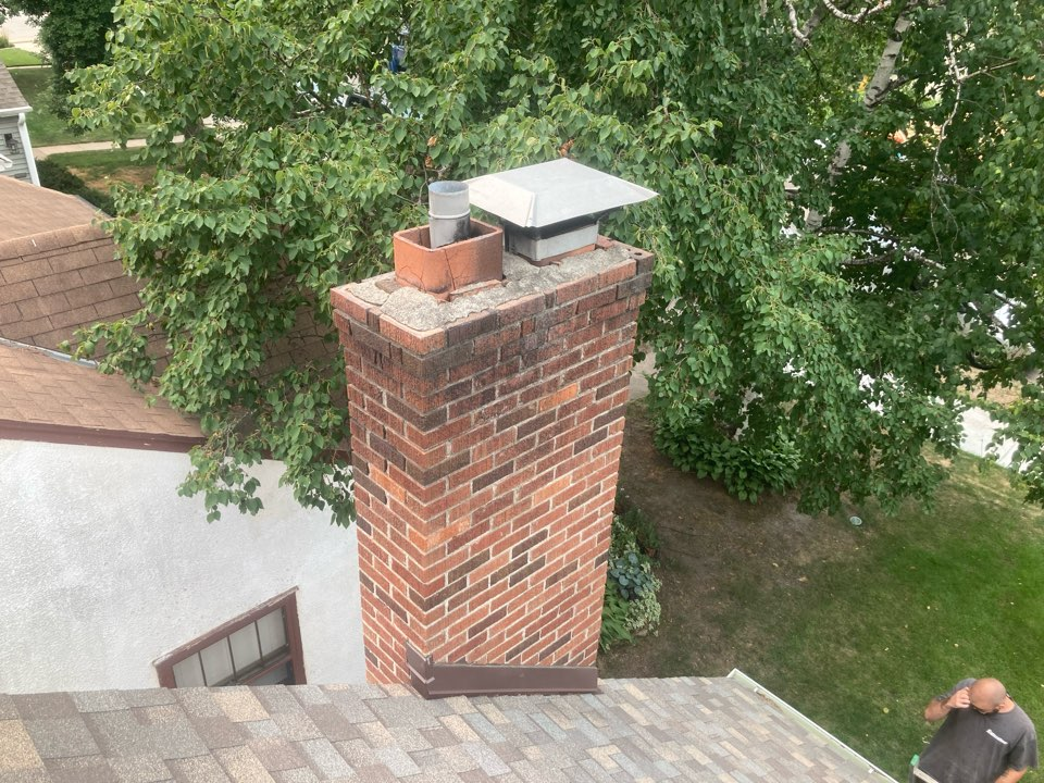 Minneapolis, MN - Booked for a new crown- shoulder repair - brick washing and sealant - new caps