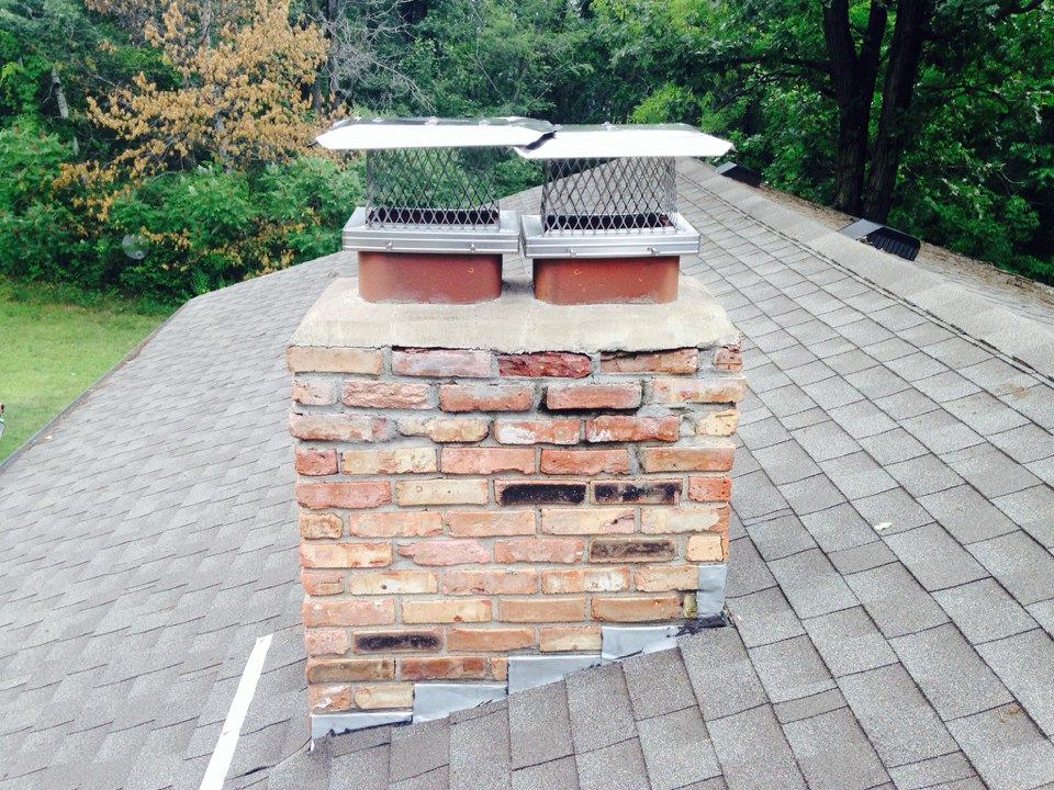 Oak Grove, MN - Double chimney cleaning and ChimScan inspections also installed two new screens
