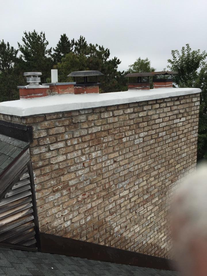 Hudson, WI - Repaired chimney crown.