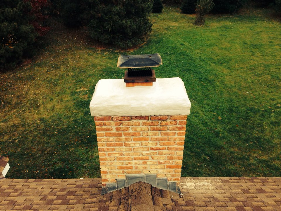 White Bear Lake, MN - Chimney cleaning and SmartScan flue liner inspection. Estimate for refractory panels, applyed an appoxy coating to the crown and a sealant to the brick work