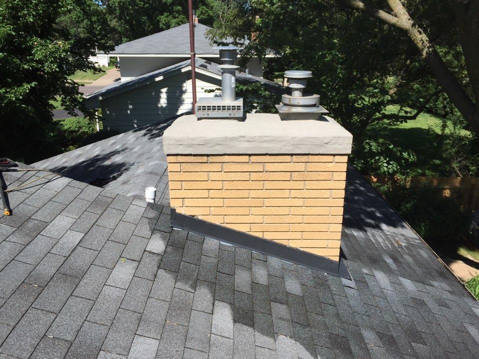 White Bear Lake, MN - Crown repair, brick repair, brick sealant, exterior chimney wash.