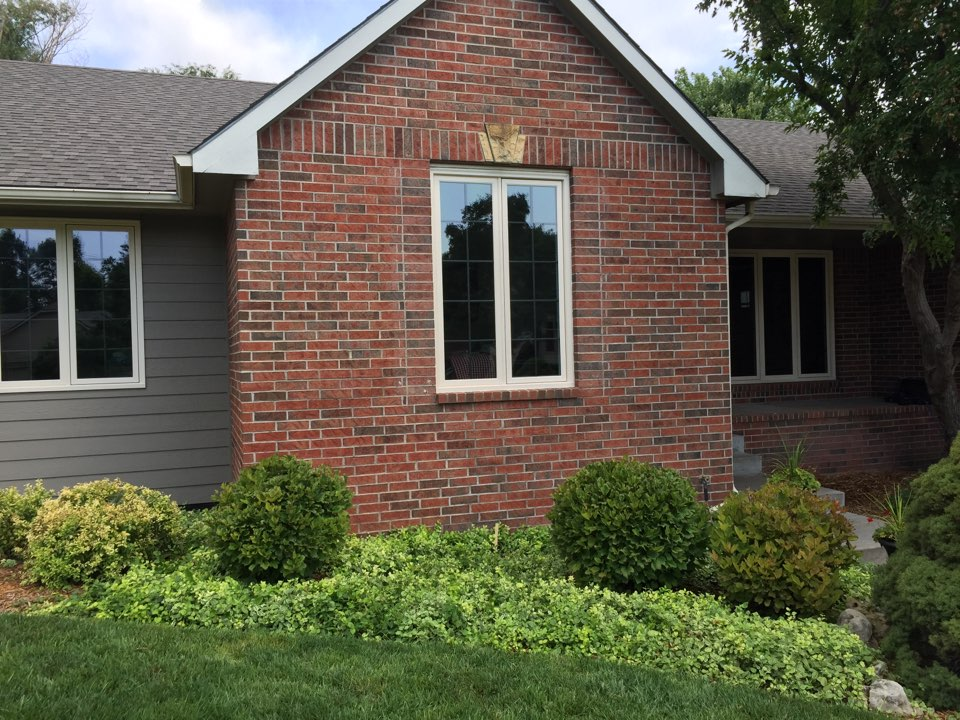 Wichita, KS - Installing new Full Fame windows antique linen exterior new Madera interior trim.