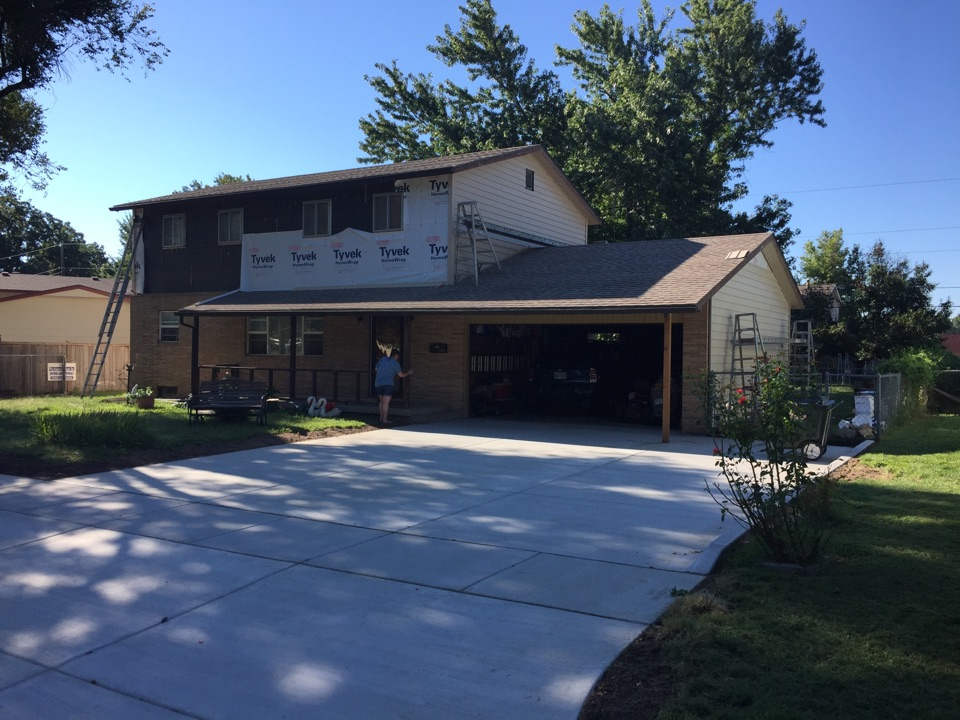 Wichita, KS - Installing new Structure insulated vinyl siding. Covering all trim. Maintenance free!