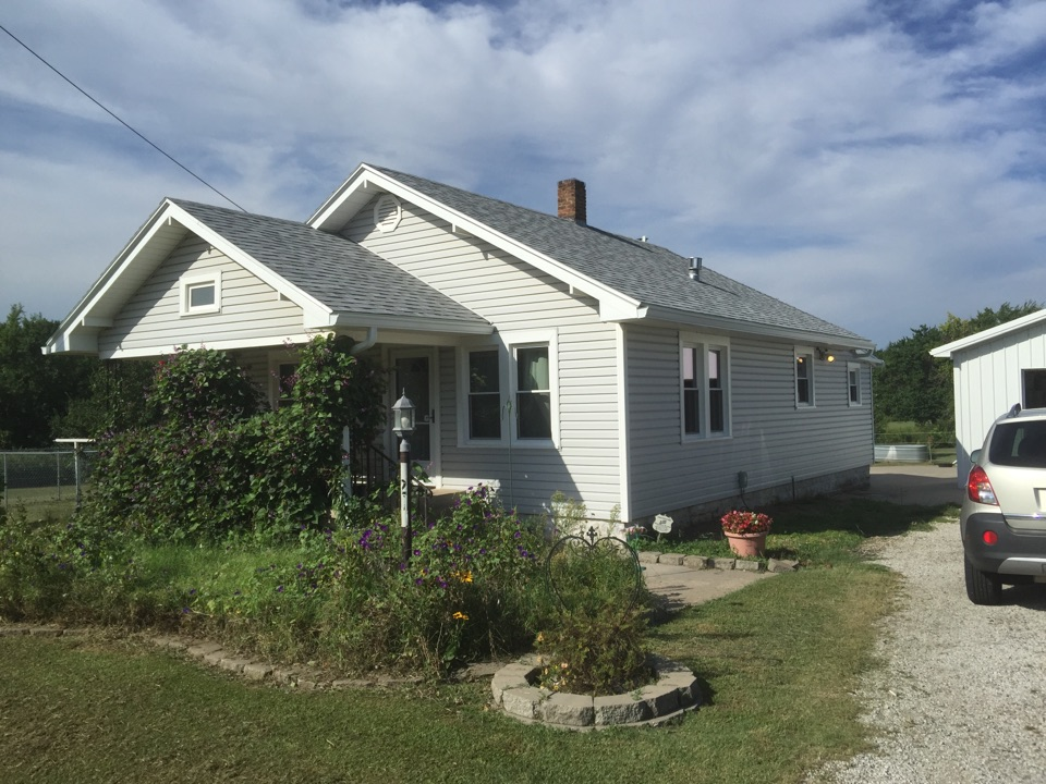 Park City, KS - All new vinyl siding with built in foam insulation backing. All new replacement windows with triple pane glass, covered all overhang trim and large guttering.