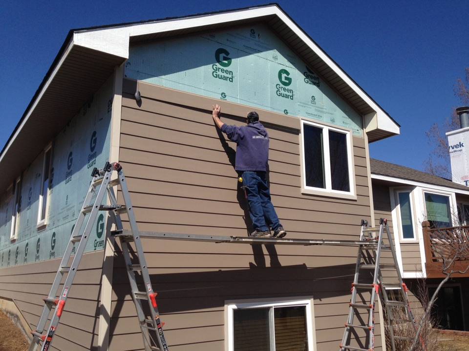 Wichita, KS - EVERLAST siding, house wrap plus an extra layer of insulation. All overhang trim, window/door trim is maintenance free as well as the siding.