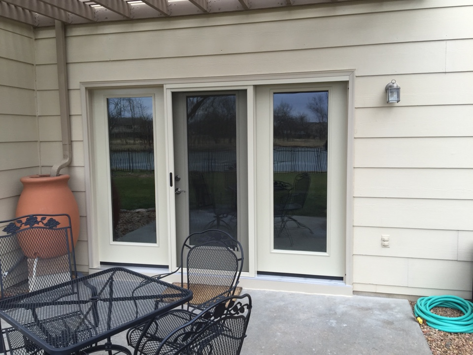 Derby, KS - Replaced drafty slider windows and large patio door with casements and hinged patio door. All new units have high efficiency glass.