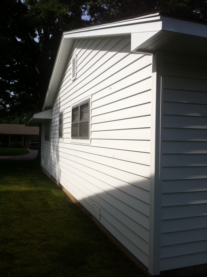 Wichita, KS - No more painting....EVER! With beautiful all white Everlast siding and soffit and fascia and our oversized gutter and downs... Making Wichita beautiful 1 house at a time!!