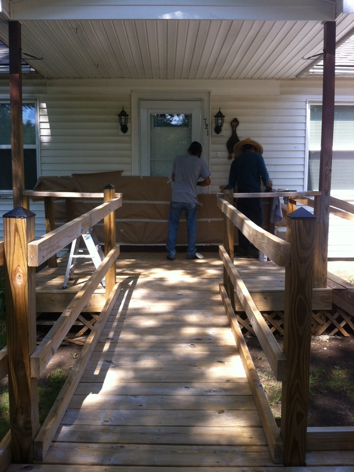 Wichita, KS - Existing Deck and ramp staining going on today, just finished new Heritage style roof and siding is next!!