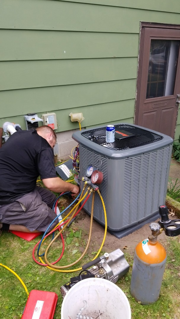 Install new Amana air conditioner