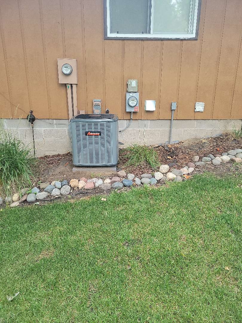 Cambridge, MN - AC install, installed Amana air conditioner and fresh air intake for the utility room.
