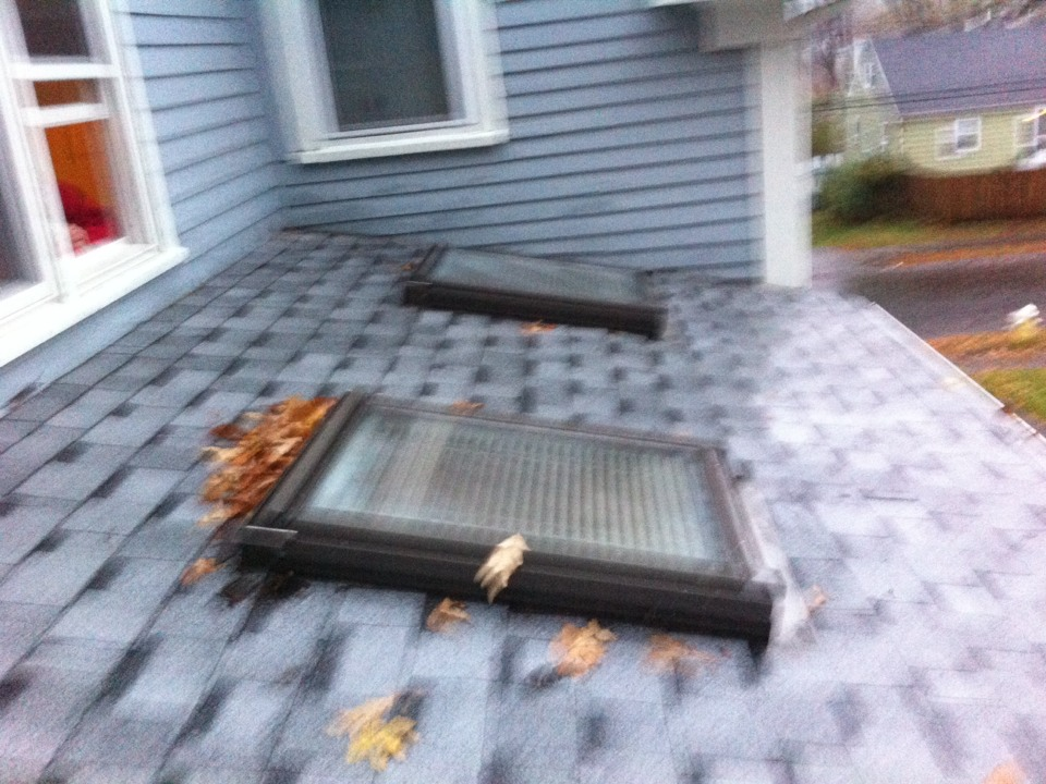 Danvers, MA - Looking at some leaky skylites in the rain that a previous roofer should have pushed to replace at that time