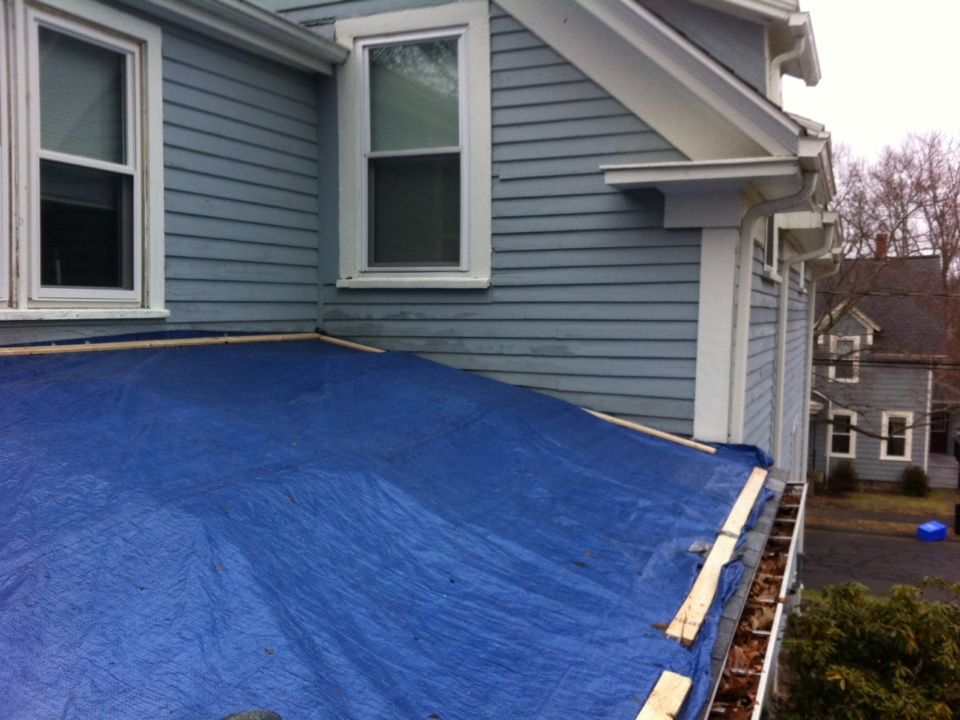 Danvers, MA - Tarp ing off a leaky roof for a new customer in Danvers in preparation for a rainstorm to keep him out of the water until next week when I can get to the roof project. The previous roofing contractor should have pushed to redo the skylites when the roof job happened because they have seen their life.