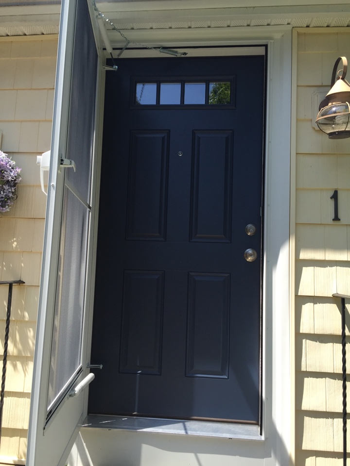 Marblehead, MA - Checking on the final product on a prefinished fiberglass entry doors and new storm doors project for a previous cedar  impressions vinyl siding project customer