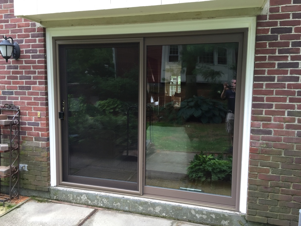 Swampscott, MA - Checking on an 8ft. Vinyl sliding patio door project we just finished in Swampscott.  Looks good Works good. Customer is happy
