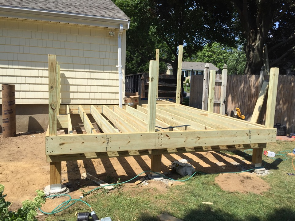 Beverly, MA - Building a maintenance free deck today for a previous vinyl siding customer in Beverly