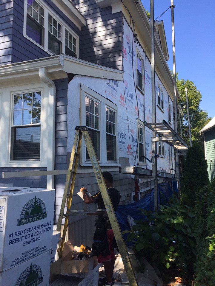 Salem, MA - Working on a wood shingle siding project with some vinyl double hung replacement windows in Salem