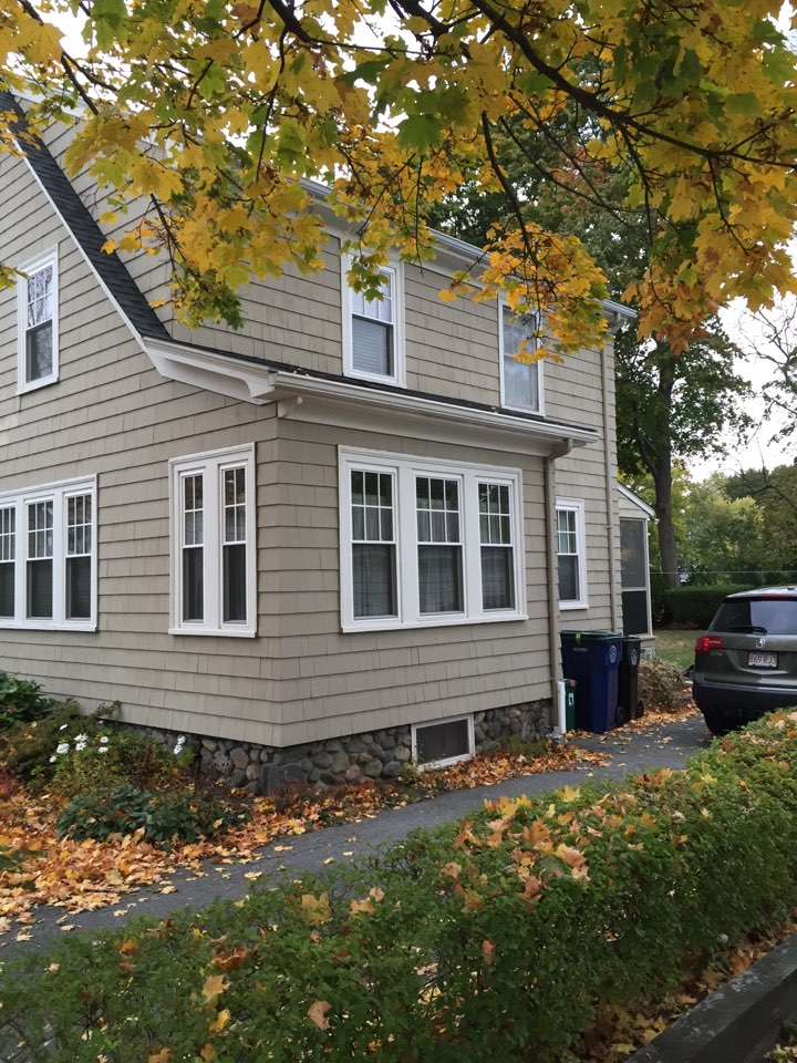 Salem, MA - Securing a window project in Salem with vinyl double hung replacement windows with SDL grids that the owner loves and that really make her house look stunning