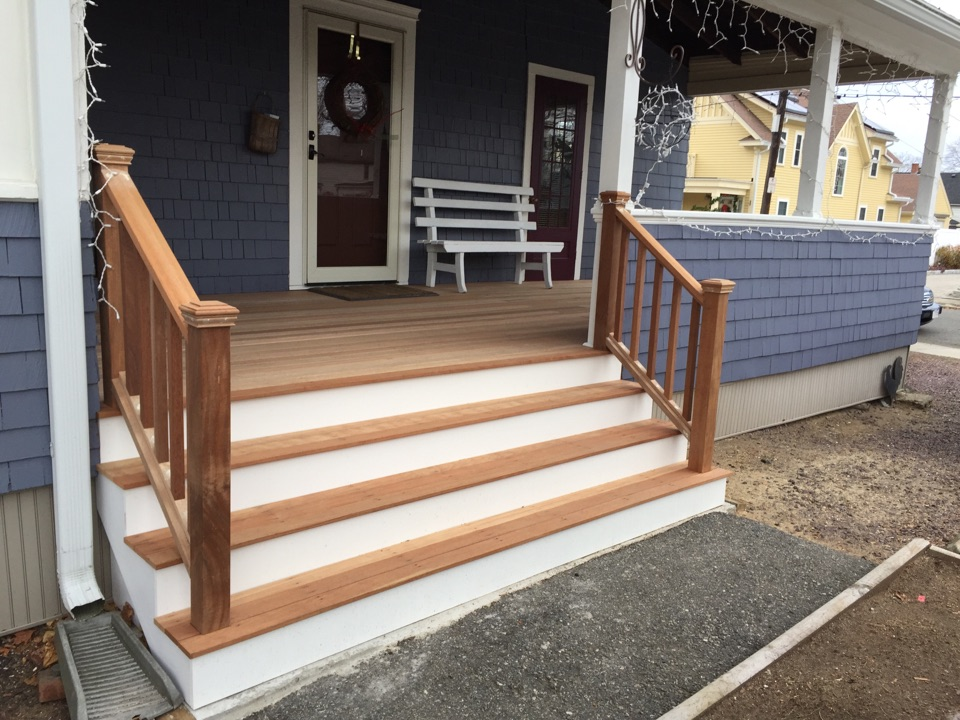 Salem, MA - Checking on a porch rebuild we recently completed with mahogany in Salem Willows neighborhood. This is a multiple repeat customer who we have done replacement windows, roofing, wood shingle siding and entry doors for them also. The porch looks awesome and they are very happy!