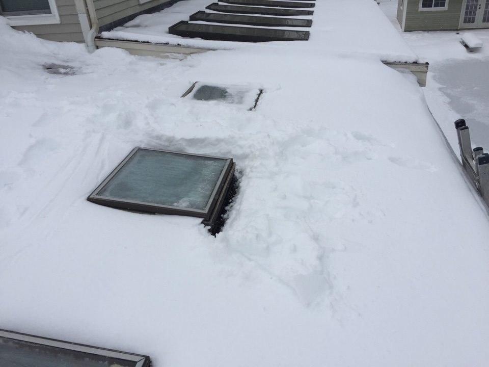 Danvers, MA - Estimating a rubber roof with 3 new skylights for a customer in Danvers. Don't you just love the snow?