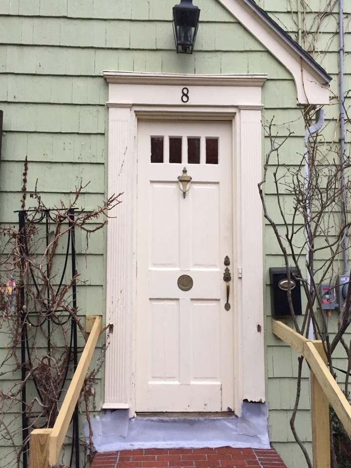 Salem, MA - Securing an entry door project with a new storm door and a fancy custom carpentry surround system for a door in Salem.