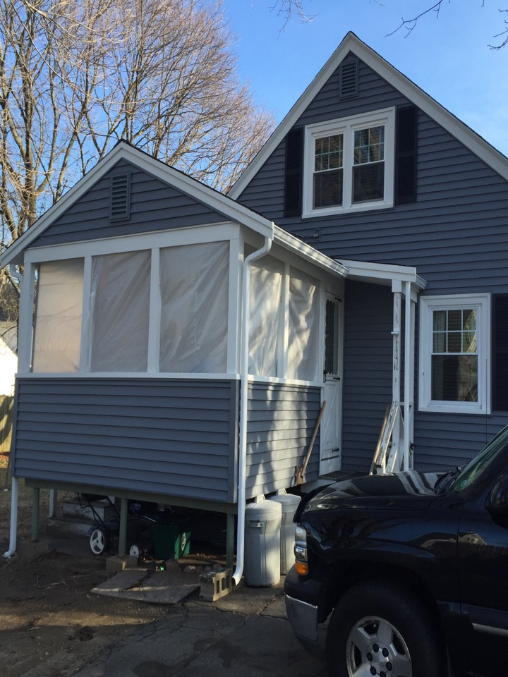 Peabody, MA - Securing the job site for a rolling storm window project for a customer in Peabody who we recently completed a full vinyl siding project for.
