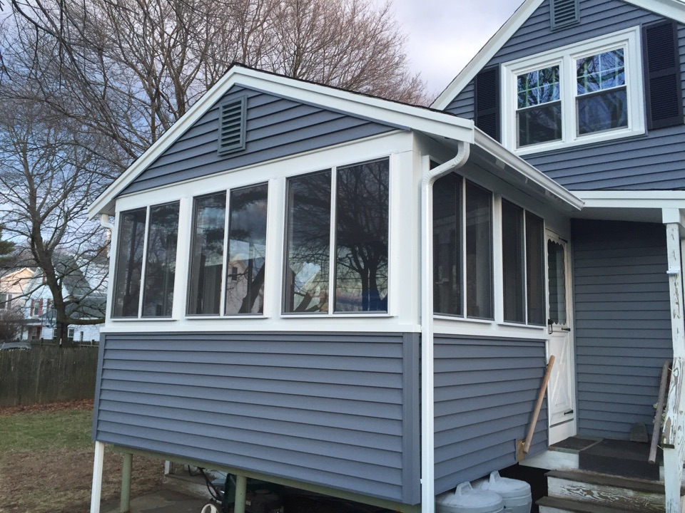 Peabody, MA - Checking on a recently completed rolling storm window job that really cleaned up a porch on a recent vinyl siding job we did in Peabody.