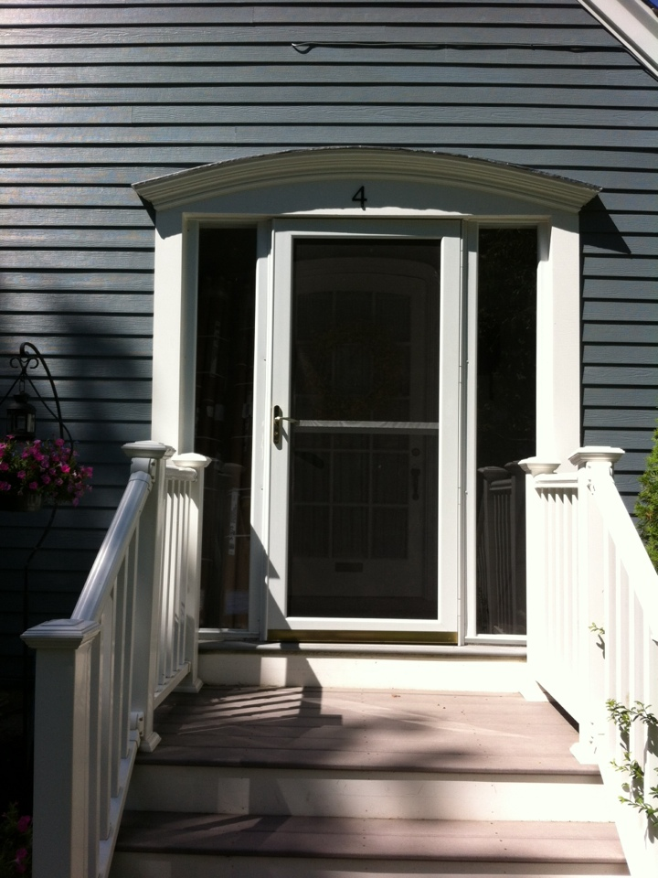 Andover, MA - Adjusting a storm door for a customer who we recently did a fibercement siding job for in Andover Ma