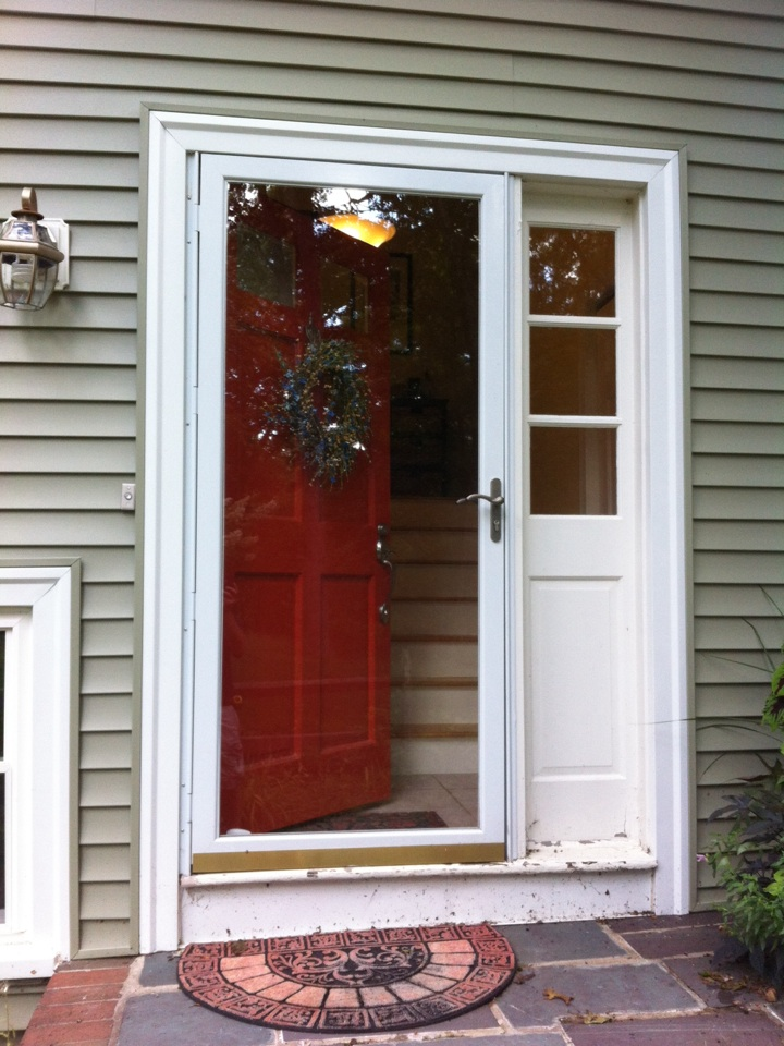 Boxford, MA - Estimating an entry door with sidelight storm door and aluminum work in Boxford Ma