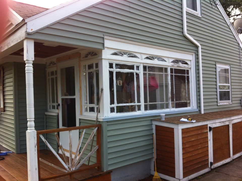 Peabody, MA - Securing a window project in Peabody Ma where we are weather ozone an enclosed porch, closing in one window and installing double hung and slider vinyl windows with aluminum coverage on exterior trim  carpentry on interior and vinyl siding alteration