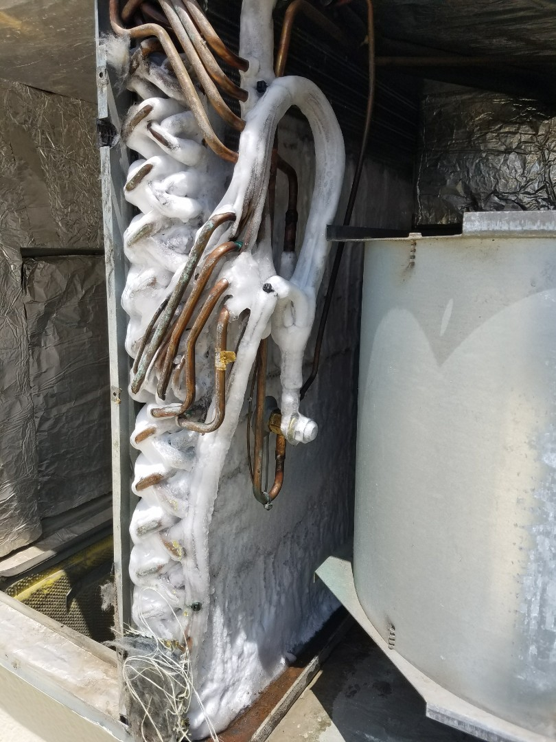 Canyon, TX - Diagnosing a Trane packaged unit. Found a frozen evap coil.