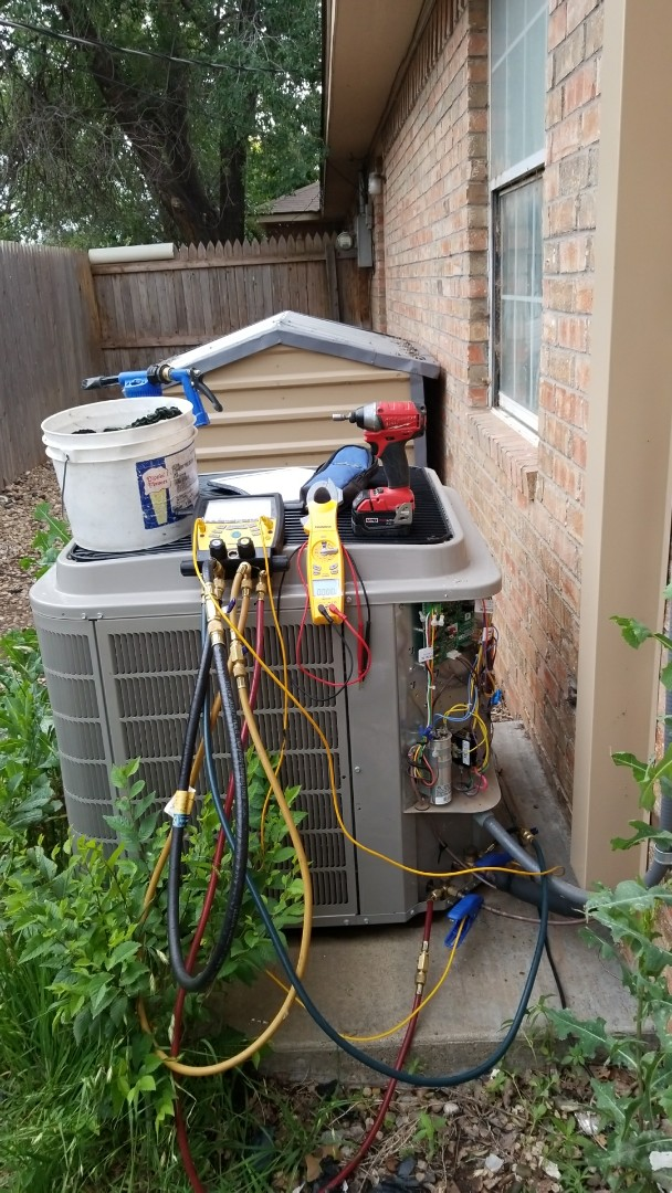 Canyon, TX - Cleaning and servicing  Bryant system!