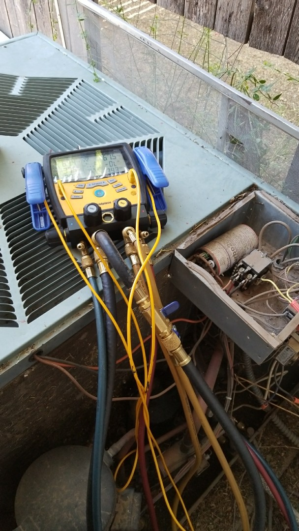 Canyon, TX - Checking Rheem system.