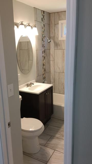 Independence, MO - Bathroom Remodel.  Full demo through to completed project.  Tile walls in bath/shower enclosure, floors, vanity, lavatory, fixtures and mirror.