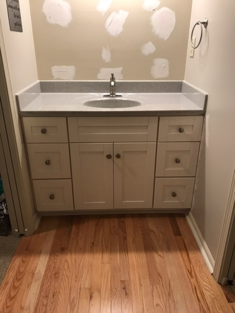 Lee's Summit, MO - Onyx countertop with new cabinet and single lever faucet.