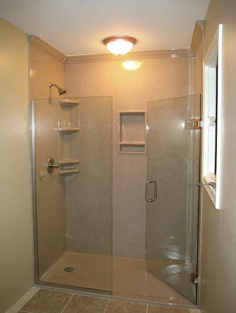 Lee's Summit, MO - Shower remodel with the Onyx Collection wall surrounds, accessories and clear glass doors.