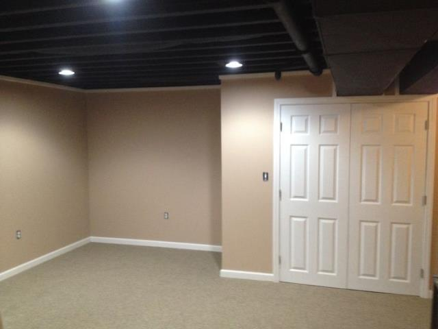 Olathe, KS - Finish basement to add additional living space as a family recreational room.  This project is a great mix of traditional with a basic painted ceiling feature.