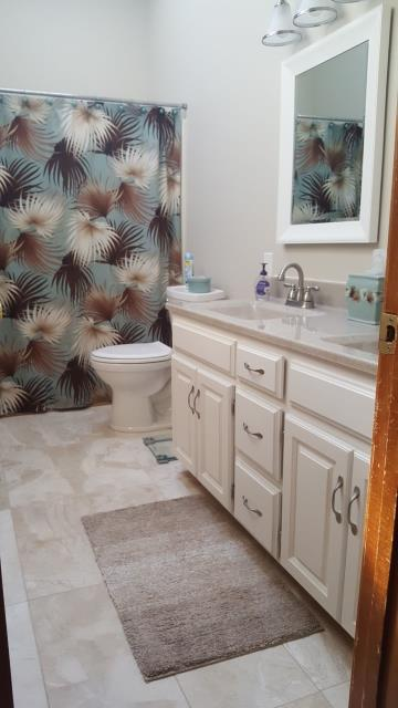Overland Park, KS - Main bath remodel.  Installation of marble tile flooring, Onyx Collection double wave bowl vanity top, refinish cabinet base with warm cream Sherwin-Williams paint, new brush nickel draw/door pulls, new vanity mirrors in white, and brighting up the room with fresh paint and all new lighting fixtures.
