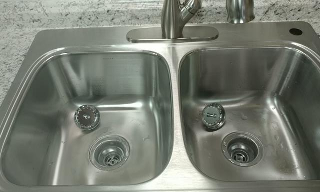 Lee's Summit, MO - Basement kitchen remodel- stainless steel half and half sink, quick pull faucet.  Great size and function for any size kitchen.
