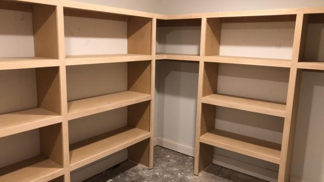 Raymore, MO - Installation of space saving, angular closet and shelves to maximize space and help with organization.