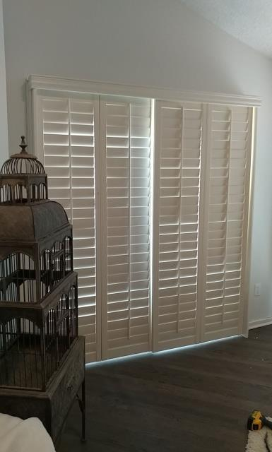 Lee's Summit, MO - Plantation Shutters installation.  Gives privacy and shade with a great look for any room.